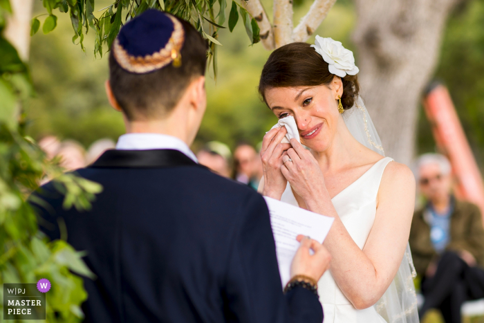 Bride getting emotional during the wedding ceremony outside at the Big Table Ranch, Coulterville, California