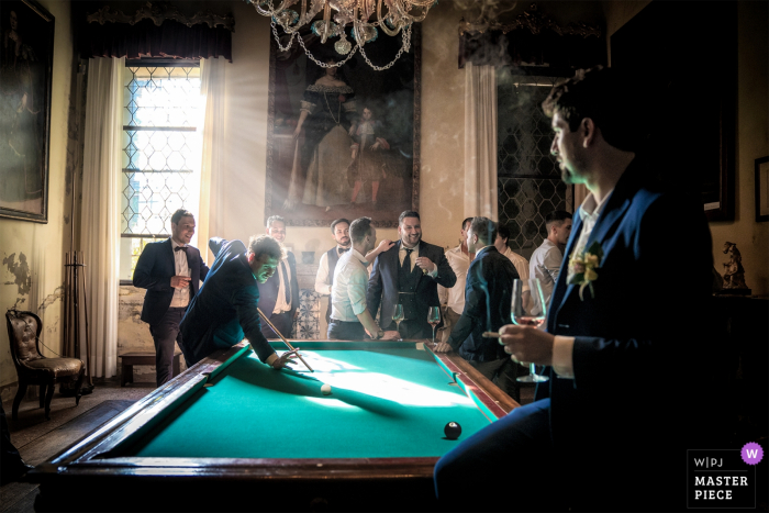 Venice groom and guests playing pool before the wedding