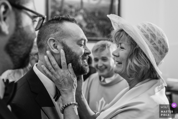 Candeleda groom smiles as his mother hugs him after the wedding