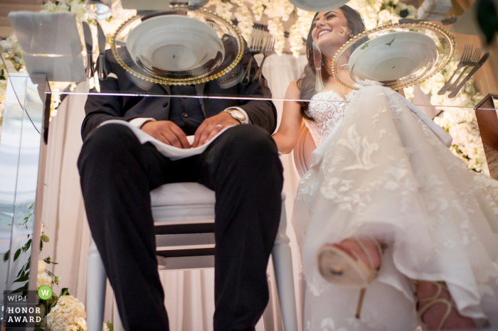 Westin Hotel, Halifax, Nova Scotia - bride and groom at the head table as shot from below their glass table