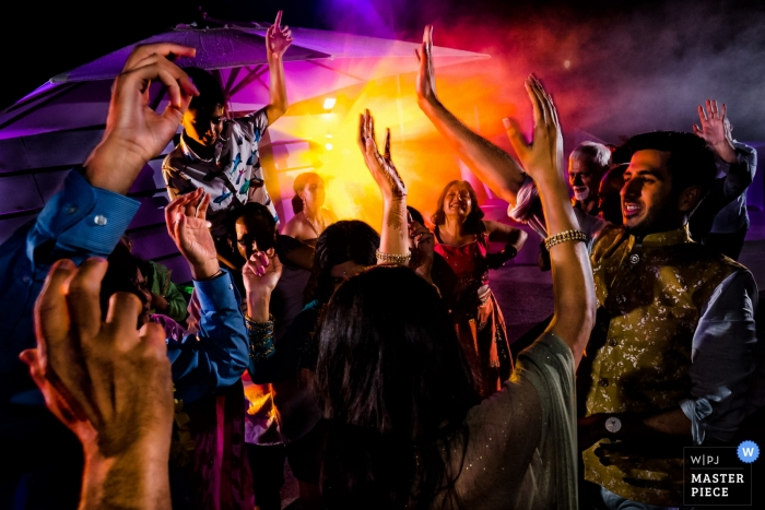 Croatia Wedding Photojournalist | very colorful Image of guests dancing at the wedding reception