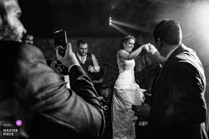 Goiás Wedding Photojournalist | Goiânia wedding reception dance floor image of the bride and groom dancing