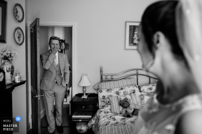 Northamptonshire Wedding Photojournalist   the bride during the first look in the bedroom