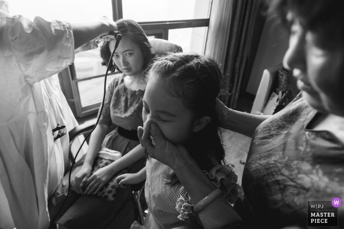 Hunan Wedding Photojournalist | China bride having her hair curled before the actual wedding ceremony