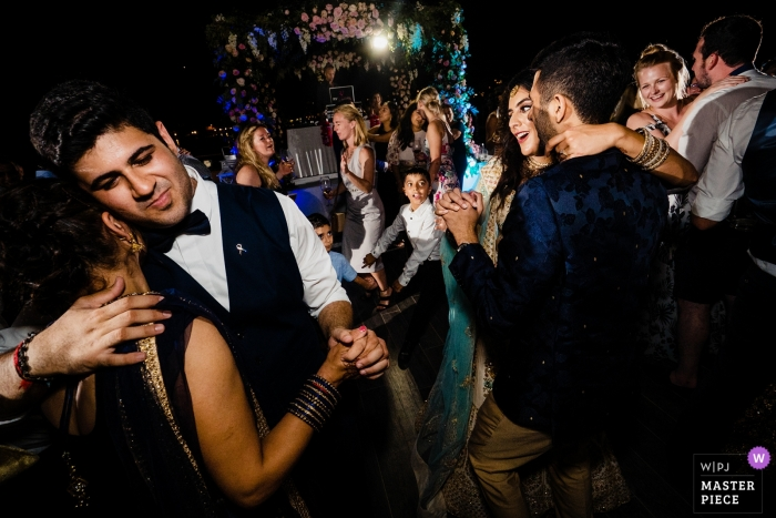 Genoa wedding reception dance party photography by ho Chi Minh Vietnam photographer