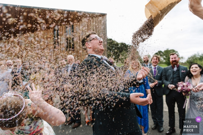 Rainford, UK a Couple get showered with confetti after their wedding ceremony
