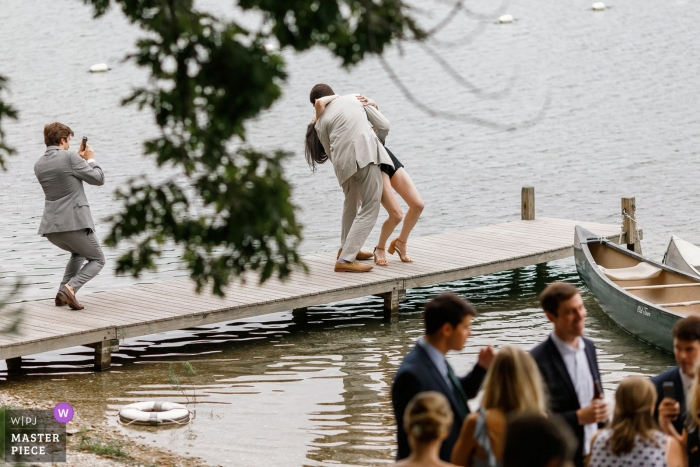 Plymouth wedding photo of a gentleman dipping a woman on a boat dock   wedding photograph from Ma