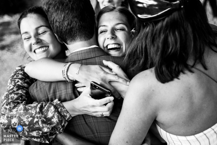 Florence, Italy wedding photo of the bride hugging guests