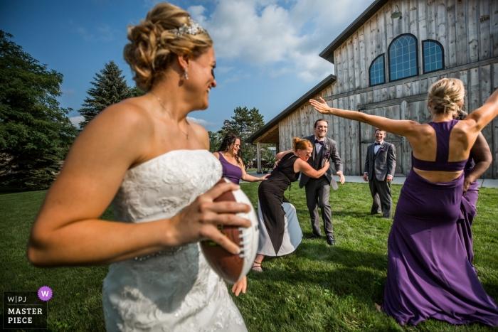 bride playing football   Quarterback Bride  Minneapolis Minnesota