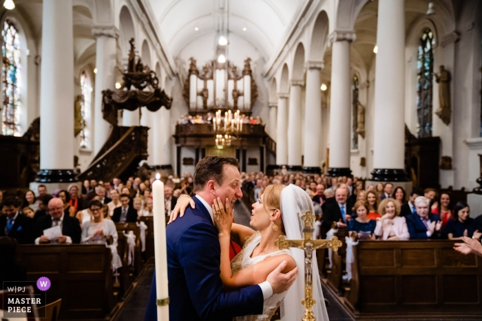 Breda couple before the kiss during their indoor church wedding