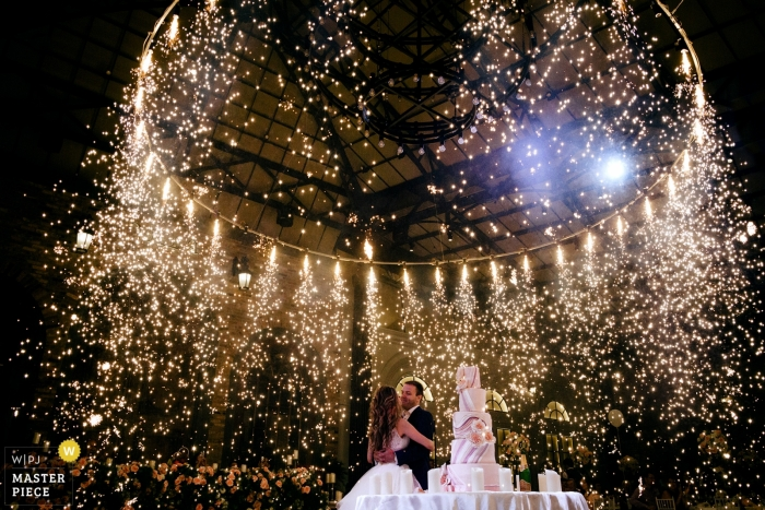 Armenia couple during their wedding cake cutting ceremony under a shower of fireworks sparks