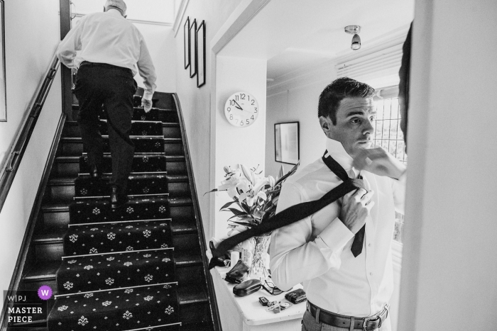 Australia wedding photo of a groom tying his tie in the mirror | Berry wedding photography
