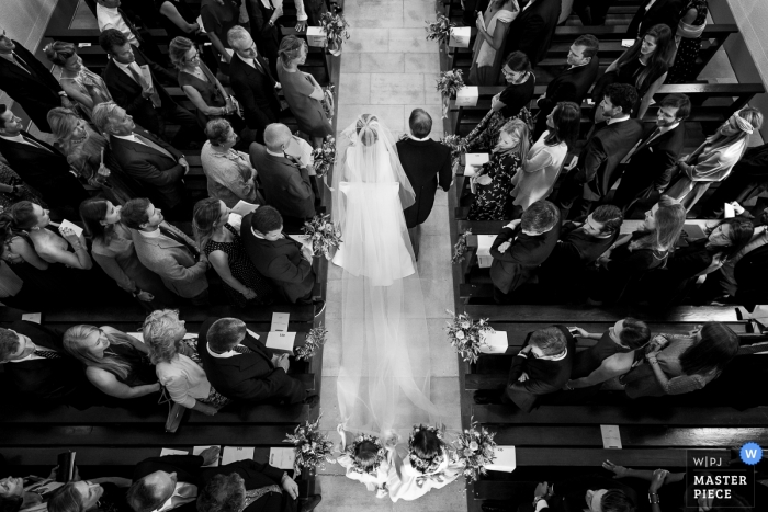 Geneva bride and father walk in to the church during the wedding ceremony - high angle overhead wedding photo
