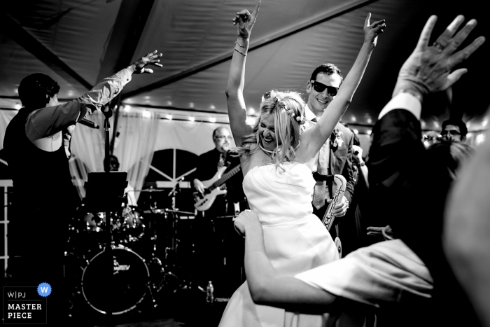 Bride getting down on stage during her wedding reception. | Camp Hale Wedding Photography