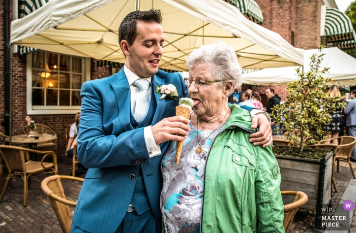 Wedding photojournalism at Rotterdam - icecream for grandmother