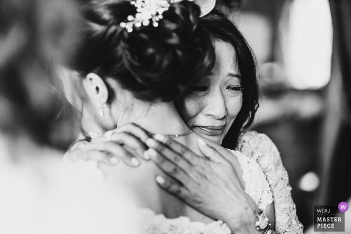Stoke Park, Buckinghamshire, UK wedding phot of bride and mom hugging.