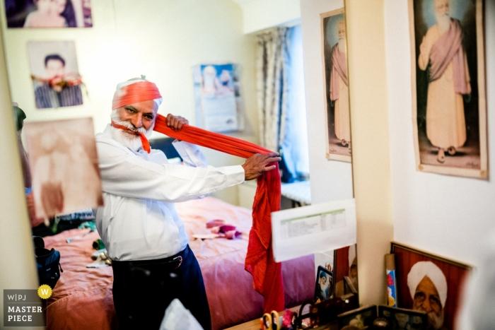 Micklefield Hall, UK documentary wedding photo of man getting ready