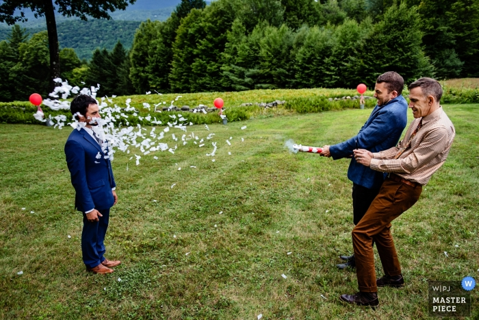 Burlington wedding photo humor | wedding photo of confetti canon blast to the face