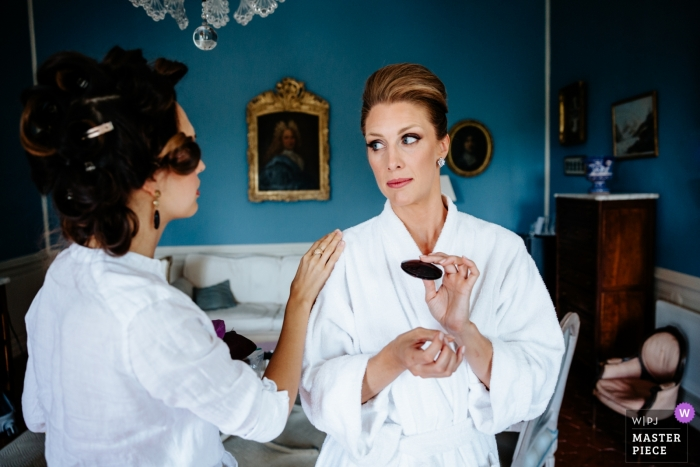 Provence - France documentary wedding photo of bride getting help with makeup