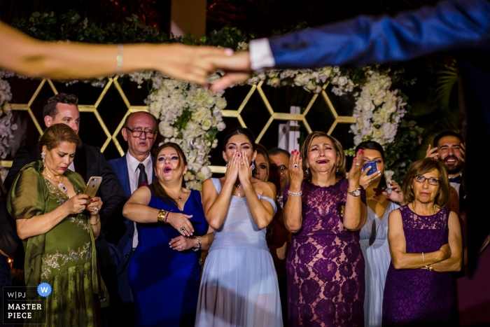 Wedding shot in Lake Tahoe of guests reacting to the bride and groom during their first dance