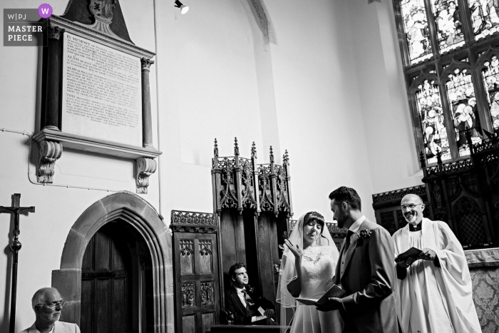 Wedding photojournalism at a Saint-Petersburg church during the ceremony