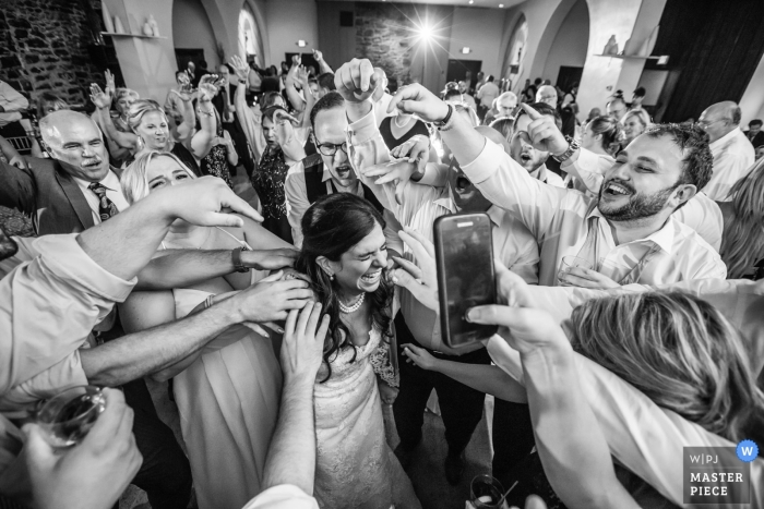 New Jersey wedding shoot with a bride surrounded by guests