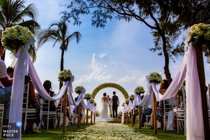 Beautiful Outdoor Wedding Scene in Thailand during the Ceremony |  Katathani Resort