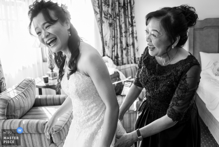 Mother of the bride sharing a laugh before an Atlanta wedding