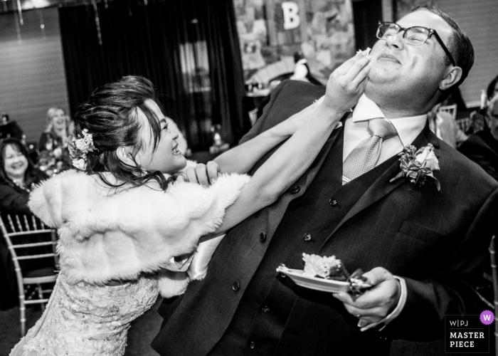 Wedding photojournalism reception cake smash for groom in Atlanta - Almost got him