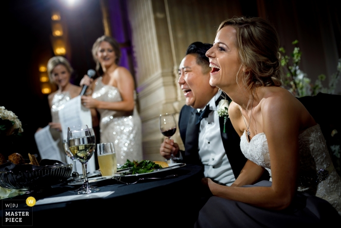 Civic Opera House | bride and groom laughing during reception speeches
