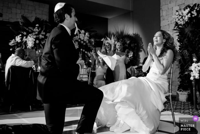 Nizuc, Cancun, Mexico couple on the dance floor during garter ritual at wedding reception