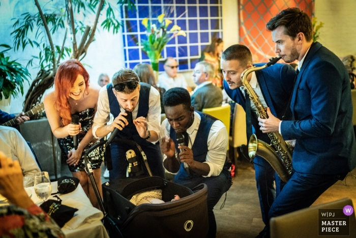 London Wedding Photography   Musicians Play for a Baby at a Quiet Wedding