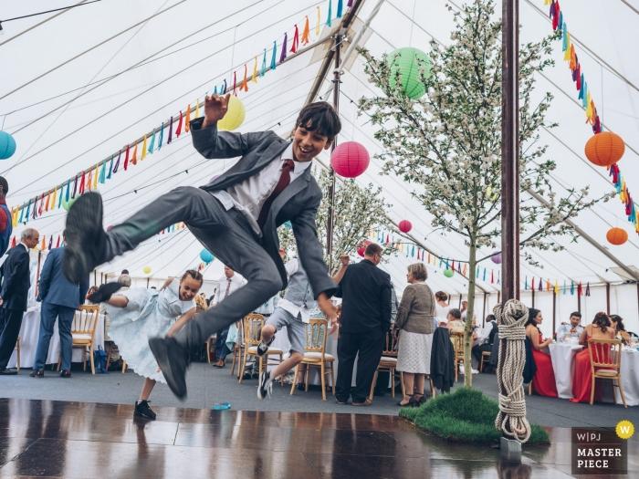 Hitchin, UK wedding reception photography of dance floor action under tent