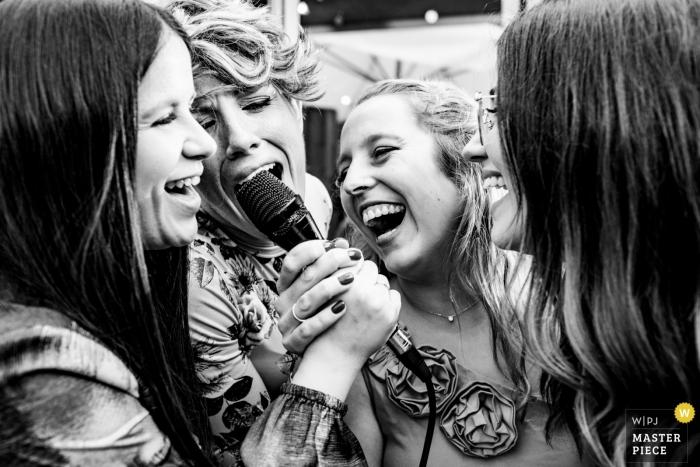 Spain Valencia wedding reception image of 4 women singing