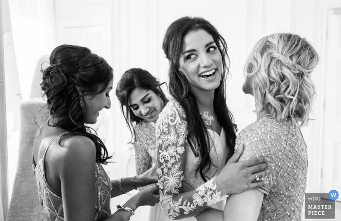Hedsor House Bucks UK Wedding Getting Ready - Doing up the dress