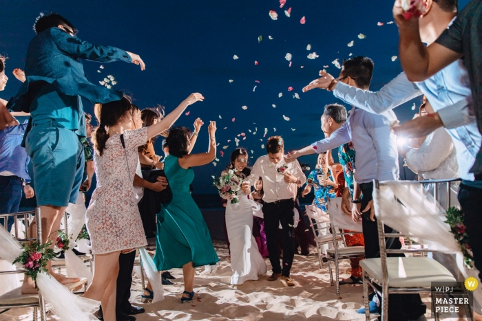 Mui Ne, Phan Thiet, Vietnam - Newly weds' exit from up their outdoor ceremony on the beach Sand