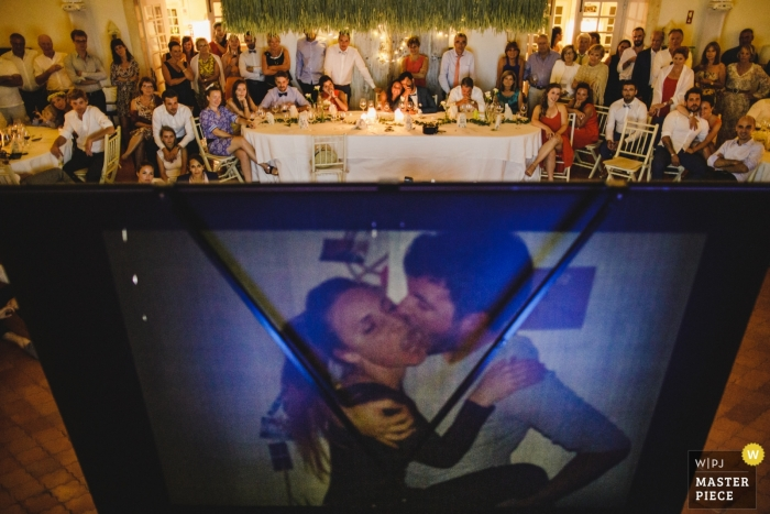 Mafra, Portugal wedding reception with a projected slideshow of the bride and groom