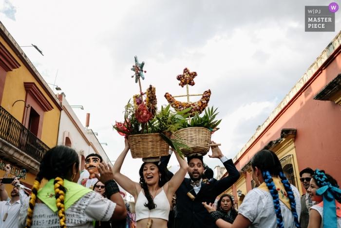 Oaxaca City, Oaxaca, Mexico - Wedding Calenda, Brian Groom walking the streets with baskets on their heads