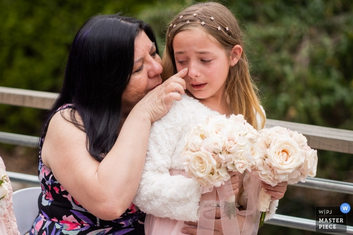 Buford Georgia outdoor ceremony wedding photography - Tears wiped away for this young flower girl
