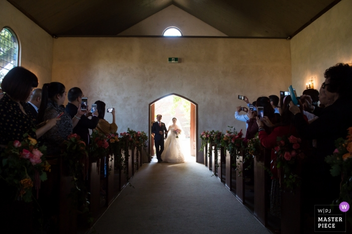 Victoria-AU wedding photographer - Wedding ceremony Image showing the bride entering the church