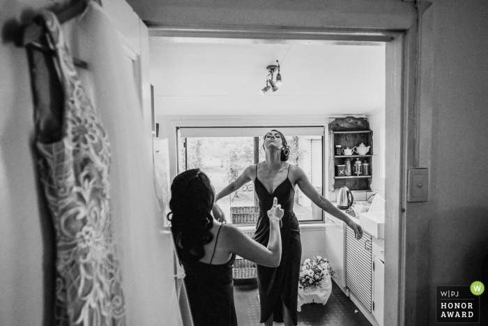 Cupitts Winery Wedding Photo - Bridesmaids spray each other with insect repellant to ward off the flies and mozzies prior to the Wedding Ceremony