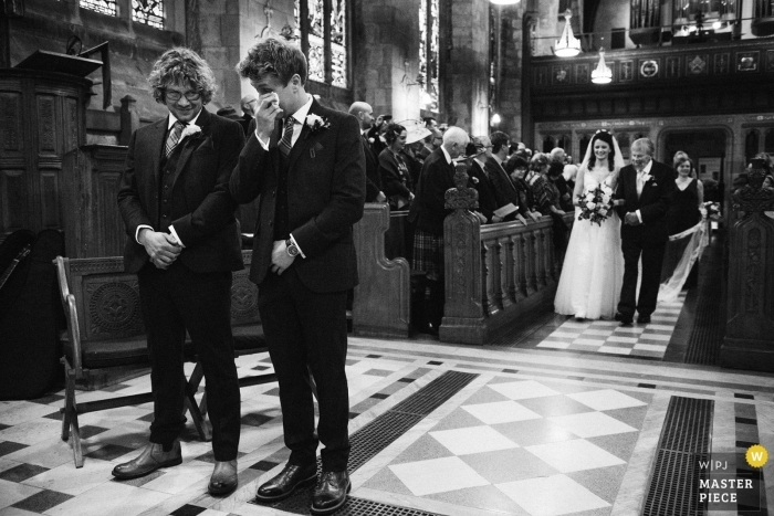 St Salvators Chapel, St Andrews wedding photography | Entrance of the bride with her father in black-and-white