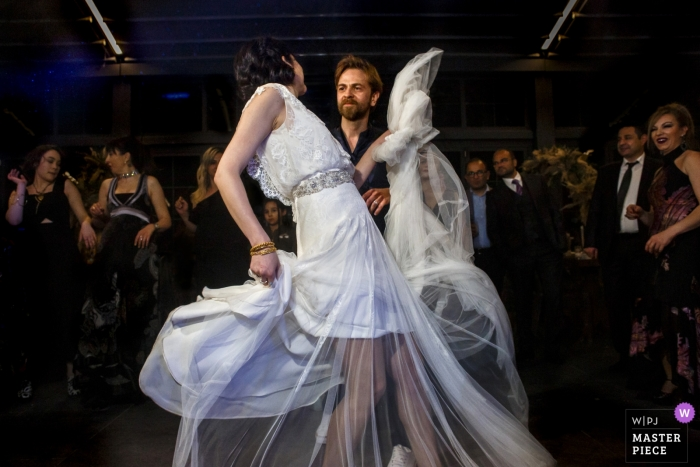 Wedding photographer for Ankara, Turkey - Pia Sera | couple on the dance floor surrounded by guests at the reception
