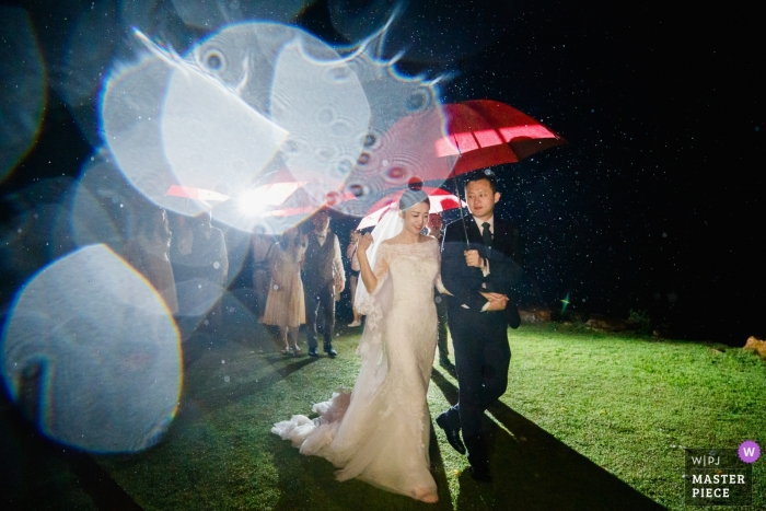 After the wedding ceremony in the rainstorm, people are leaving the location at The Ritz-Carlton, Krabi, Thailand