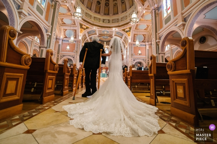 SACRAMENTO WEDDING PHOTOGRAPHY - Dad with disabilites walks his daughter down the church aisle