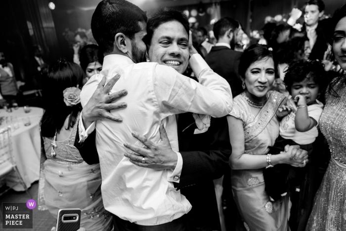 Manor of Groves, UK wedding photograph of the Dance floor hug with the groom