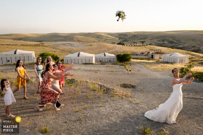 Terres des Etoiles Marrakech Wedding Photo of the Bride Throwing the bouquet