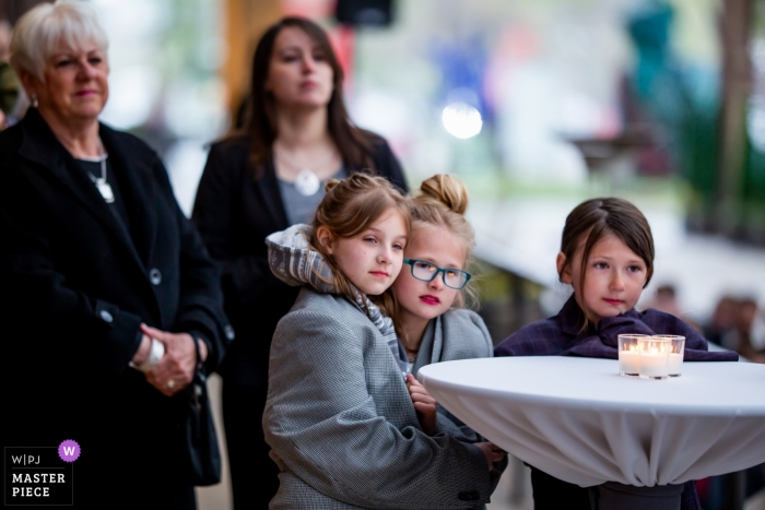 Wedding photo of little girls watching the ceremony at Bridgeport Art Center in Chicago