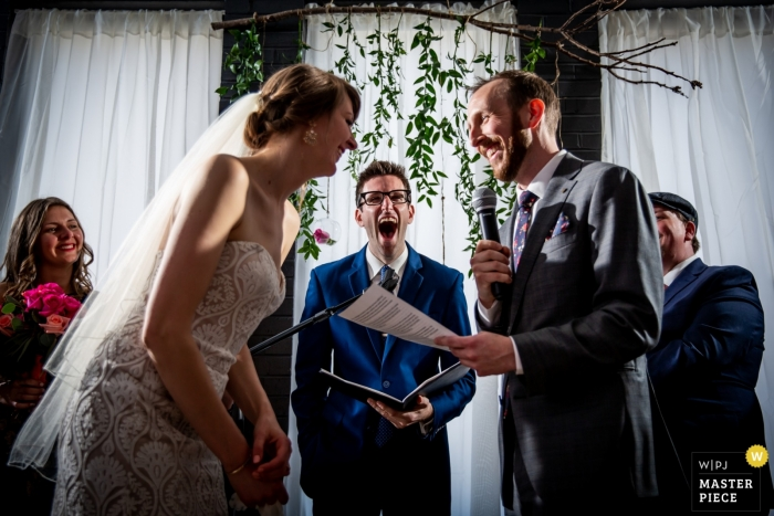 Photo of a laugh between bride and groom during the ceremony at Trigger in Chicago