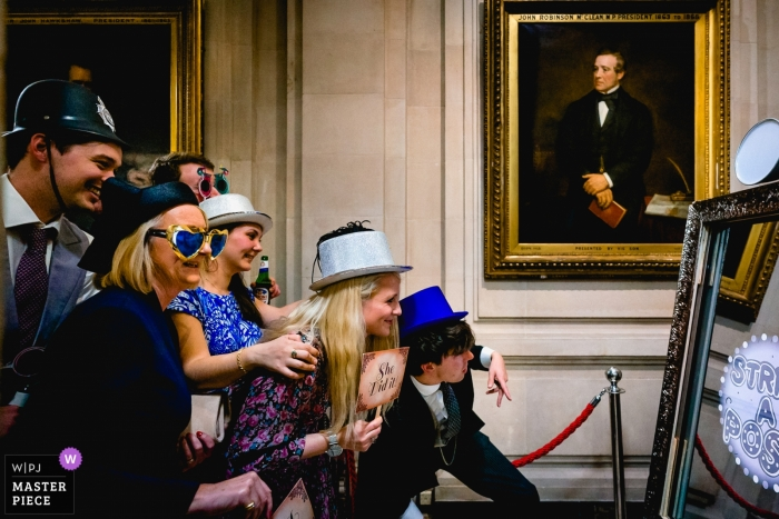 One Great George Street, London wedding photography showing the Guests at a Photo Booth